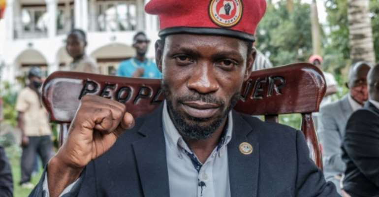 Ugandan opposition leader Robert Kyagulanyi, also known as Bobi Wine, poses for a photograph after his press conference at his home on Tuesday.  By SUMY SADURNI (AFP)