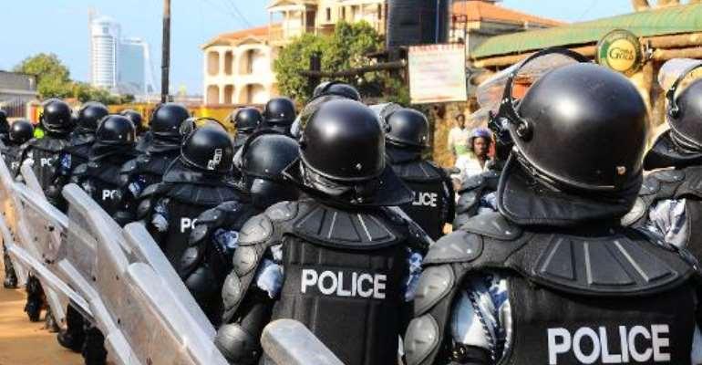 Ugandan anti-riot police patrol the streets of Kampala on April 26, 2012.  By Kasamani Isaac (AFP/File)