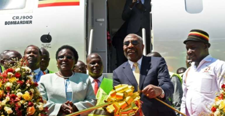 Uganda's Prime Minister Ruhakana Rugunda and Transport Minister Monica Azuba both attended the relaunch of the airline ahead of an inaugural flight from Entebbe International Airport to Nairobi.  By ISAAC KASAMANI (AFP)