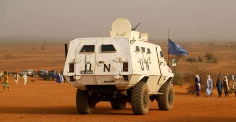 Un blindé de la mission de l'ONU au Mali dans la région de Menaka le 14 mars 2020.  By Souleymane Ag Anara (AFP/File)