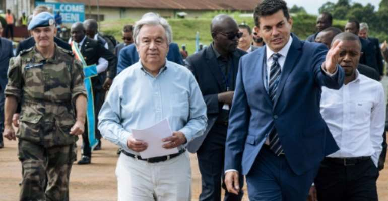 UN chief Antonio Guterres (L) promised continued blue helmet support for the Congolese army.  By ALEXIS HUGUET (AFP)