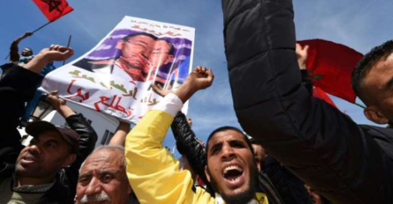 Moroccan protesters hold signs and shout slogans in the capital Rabat, on March 13, 2016, during a demonstration against statements made by the UN chief earlier in the week regarding the Western Sahara.  By Fadel Senna (AFP/File)