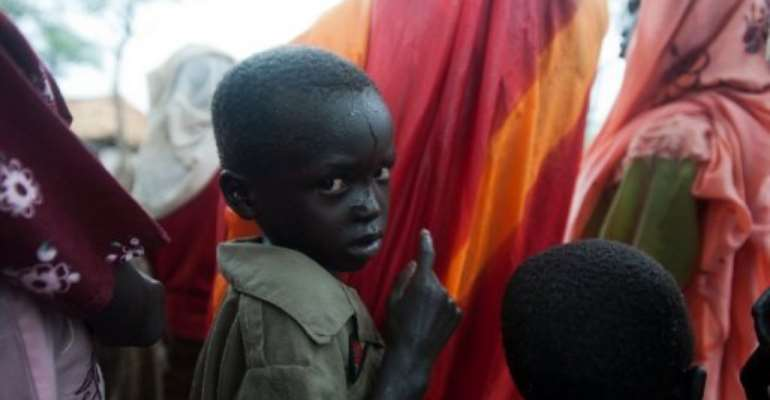 Young refugees from Blue Nile state arrive at Yusuf Batil Refugee in June 2012.  By Giulio Petrocco (AFP)