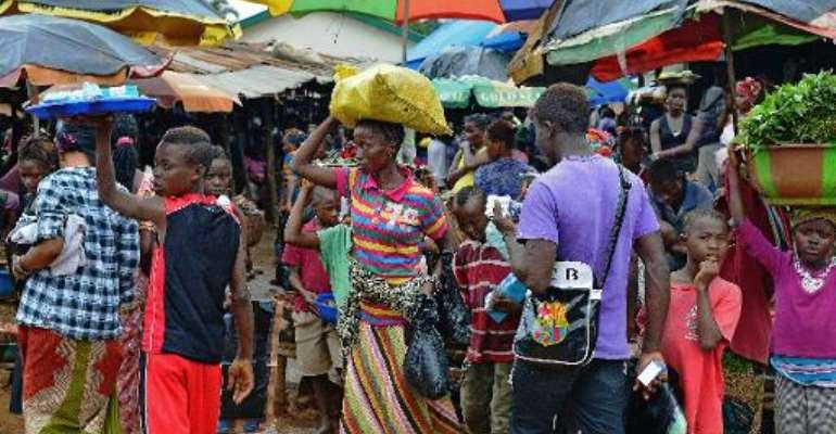 People walk in a market in Kenema, Sierra Leone, on August 16, 2014.  By Carl de Souza (AFP/File)