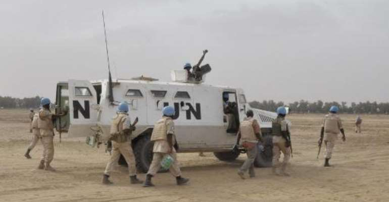 UN peacekeepers patrol on May 12, 2015 in Timbuktu.  By Alou Sissoko (AFP/File)