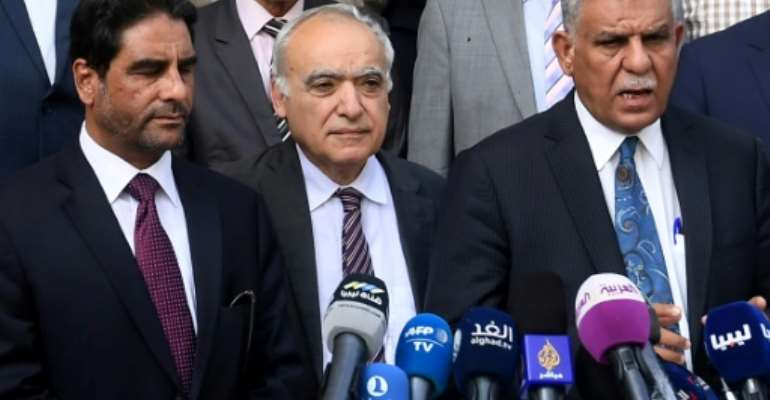UN Libya envoy Ghassan Salame (C) and representatives of the country's rival administrations speak to reporters on October 1, 2017.  By FETHI BELAID (AFP)