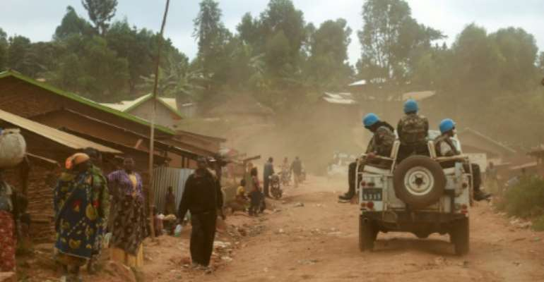 UN peacekeepers from Morocco carry out a patrol in the DR Congo in March 2020.  By SAMIR TOUNSI (AFP/File)