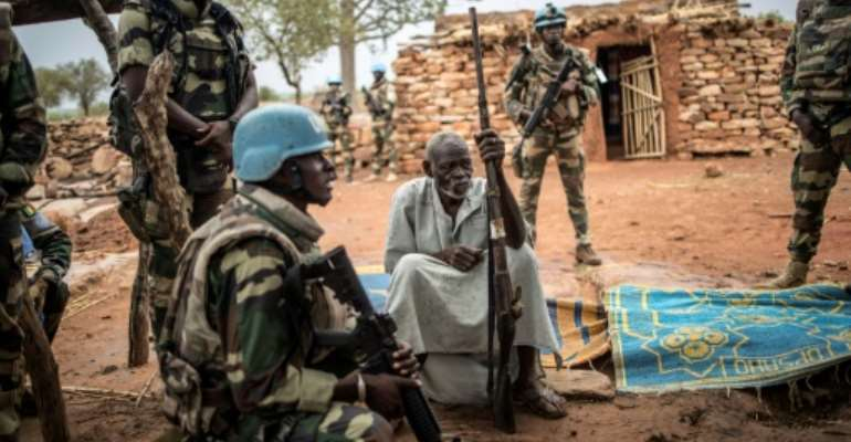 UN peacekeepers have been on the ground since 2013. Members of the 13,000-strong MINUSMA force are shown here in central Mali's Dogon region.  By Marco LONGARI (AFP/File)