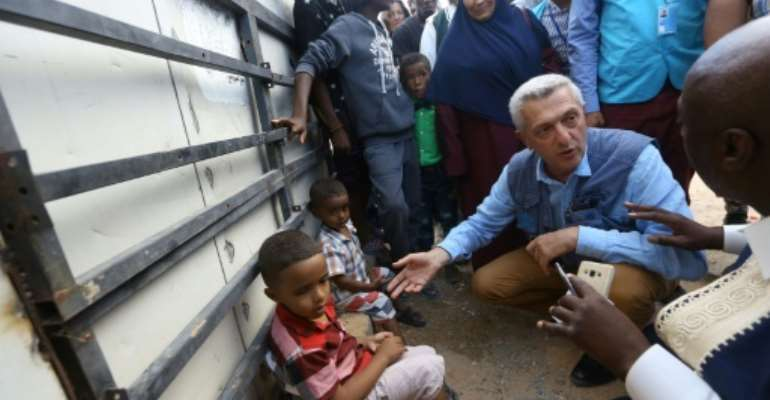 UN refugee chief Filippo Grandi (2e D) visits a camp for the displaced near the Libyan capital Tripoli.  By MAHMUD TURKIA (AFP)