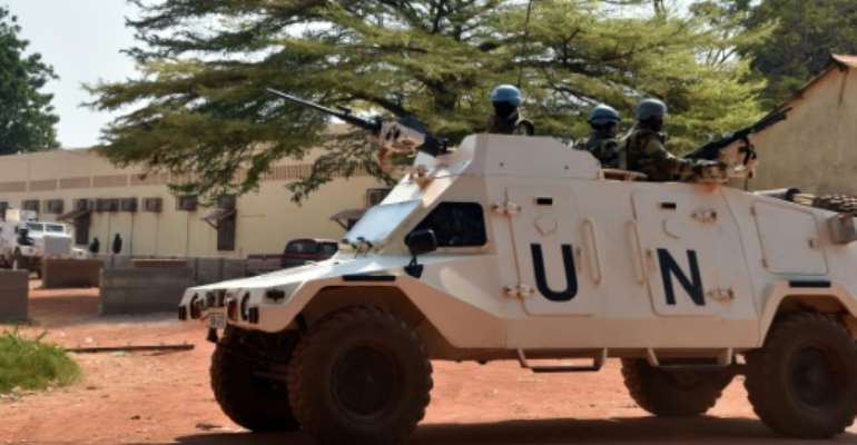 United Nations peacekeepers patrol on January 2, 2016 in Bangui.  By Issouf Sanogo (AFP/File)