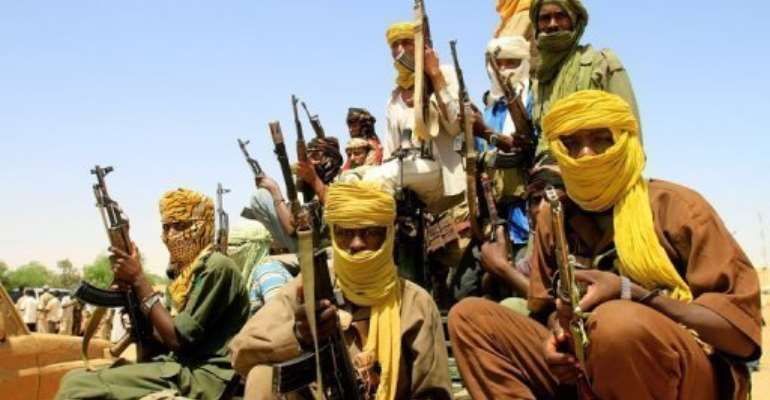 Fighters with the Justice and Equality (JEM) Movement in al-Fasher, Northern Darfur, in 2011.  By Ashraf Shazly (AFP/File)