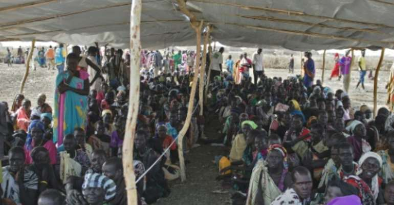 IDPs (Internally displaced persons) wait to receive food rations at the UNMISS  site in Bentiu, Unity State, on February 27, 2015.  By Charles Lomodong (AFP)