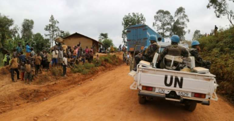 UN soldiers patrol in the violence-torn Djugu territory of Ituri province in eastern DR Congo in March 2020.  By SAMIR TOUNSI (AFP/File)