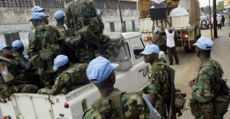 Soldiers of the United Nation Mission in Liberia collect ballot boxes in 2005.  By Issouf Sanogo (AFP/File)