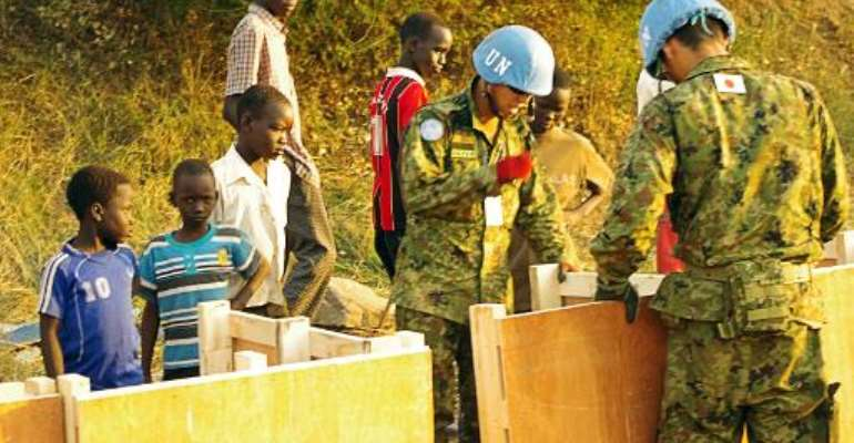 A handout photo received on December 19, 2013 from UNMISS shows officers building latrines for civilians seeking refuge in the UNMISS compound on the outskirts of Juba on December 17, 2013.  By UN Military (UNMISS/AFP)