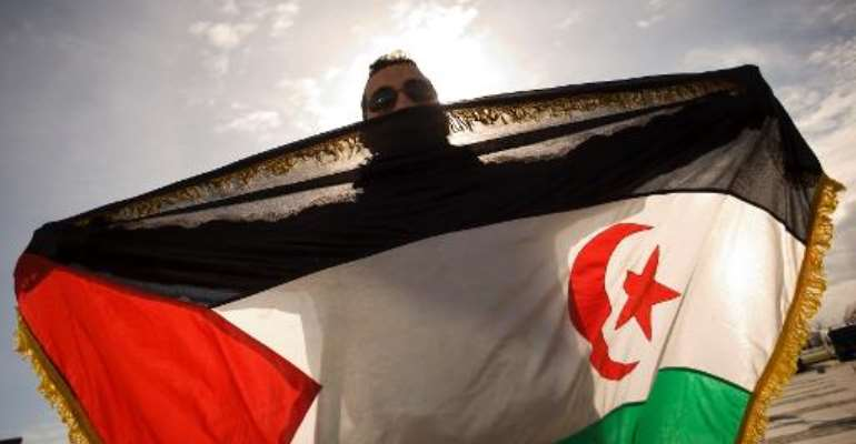 A pro-Sahrawi activist displays a Western Sahara flag as he takes part in a demonstration on December 4, 2010 in Malaga.  By Jorge Guerrero (AFP/File)