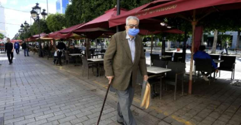 Under new measures imposed by Tunisia to stem the spread of the novel coronavirus, cafes and restaurants will be shut from 4:00 pm, and gatherings of more than four people banned in public spaces.  By FETHI BELAID (AFP)