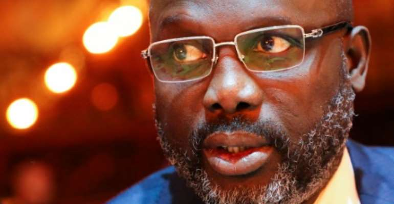 Under pressure: Football star turned president George Weah.  By ludovic MARIN (POOL/AFP)