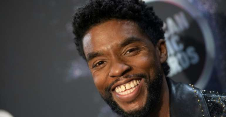 US actor Chadwick Boseman continued to work on major Hollywood films during and between countless surgeries and chemotherapy.  By Valerie MACON (AFP/File)
