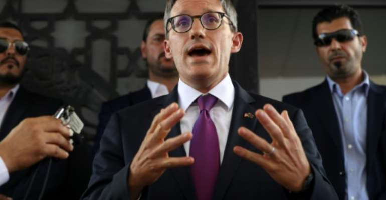 US envoy Derek Chollet (C) speaks to the media in the Libyan capital Tripoli, on September 15, 2021.  By Mahmud Turkia (AFP)