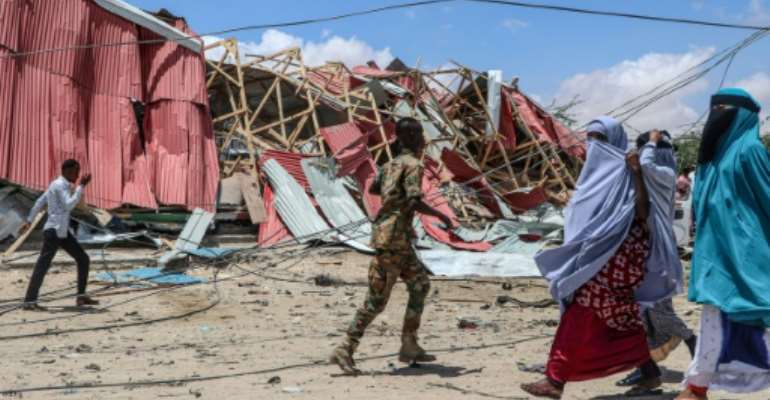 US forces, working with Somali government forces, have used drones to mount attacks on Al-Shabaab (pictured is a 2019 suicide car bomb explosion in Mogadishu, Somalia claimed by the Al-Shabaab militant group).  By Abdirazak Hussein FARAH (AFP/File)