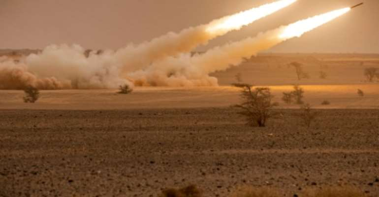 US M142 High Mobility Artillery Rocket System (HIMARS) launchers fire salvoes during the
