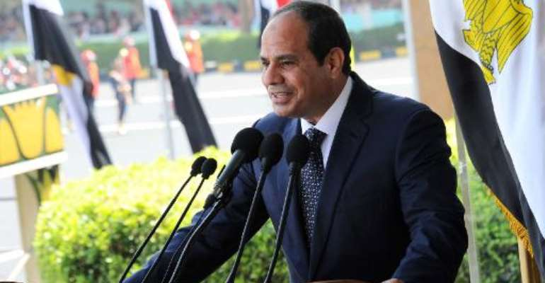 A picture released by the Egyptian Presidency on June 24, 2014 shows Egypt's President Abdel Fattah al-Sisi giving a speech during a military graduation ceremony in the capital Cairo.  By  (AFP)