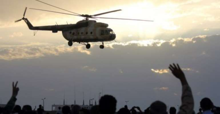 A helicopter flies over Benghazi during a military display.  By Abdullah Doma (AFP/File)