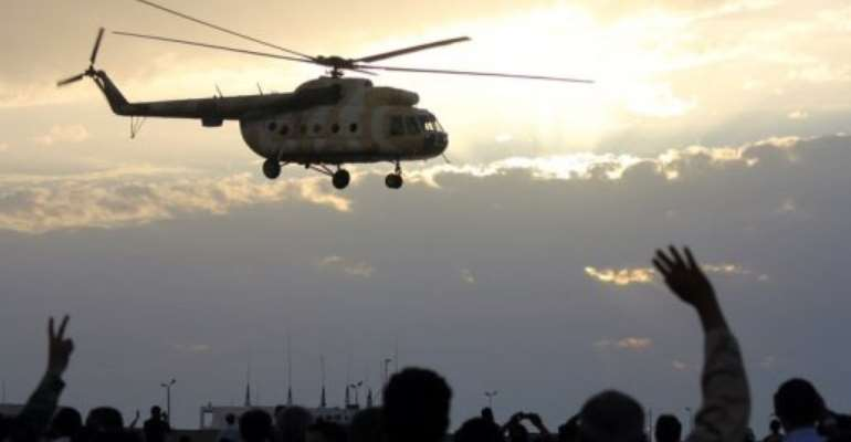 A helicopter flies over Benghazi during a military display.  By Abdullah Doma (AFP)