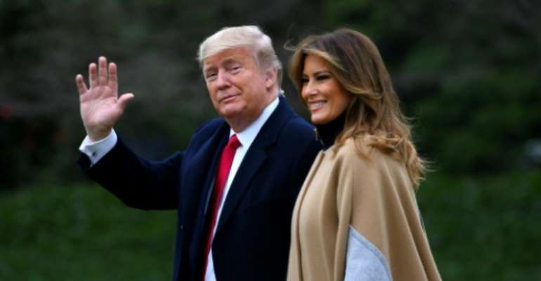 US President Donald Trump waves next to First Lady Melania Trump as they walk to Marine One before departing from the South Lawn of the White House.  By ANDREW CABALLERO-REYNOLDS (AFP)