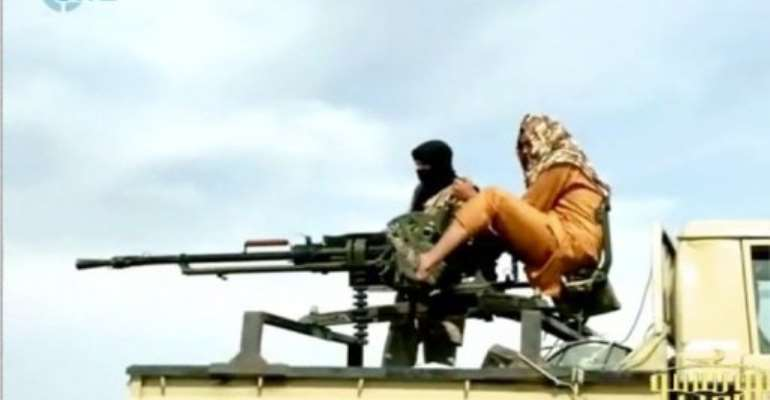 This handout photo of a video grab reportedly shows Al-Qaeda in the Islamic Maghreb (AQIM) fighters.  By  (SITE MONITORING SERVICE/AFP/File)