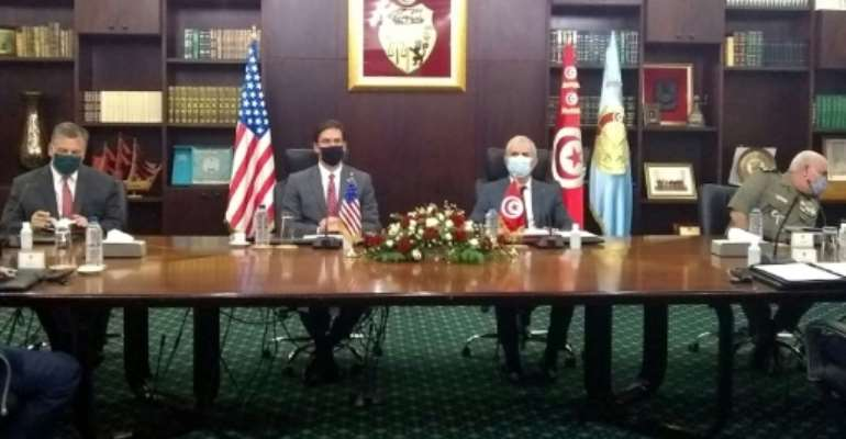 US Secretary of Defense Mark Esper, seated second from the left, meets with his Tunisian counterpart Ibrahim Bartagi, seated to his right, in the capital Tunis.  By Sylvie LANTEAUME (AFP)