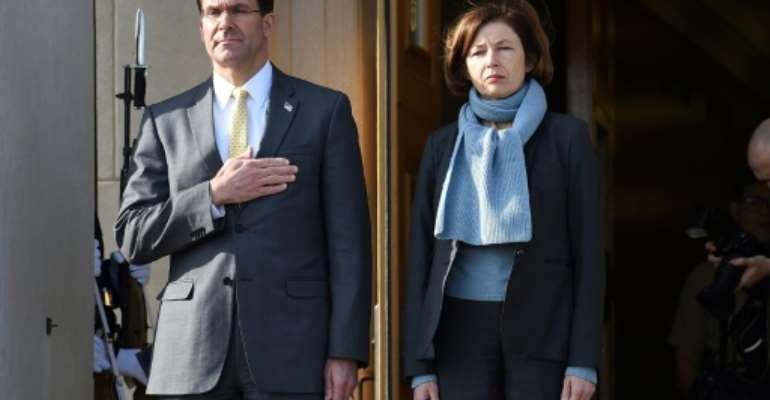 US Secretary of Defense Mark Esper welcomes France's Defence Minister Florence Parly during an honor cordon at the Pentagon.  By OLIVIER DOULIERY (AFP)