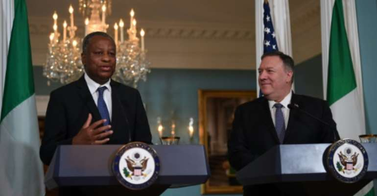 US Secretary of State Mike Pompeo and Nigerian Foreign Minister Geoffrey Onyeama deliver statements to the press after talks that included discussion of a visa row.  By Eric BARADAT (AFP)
