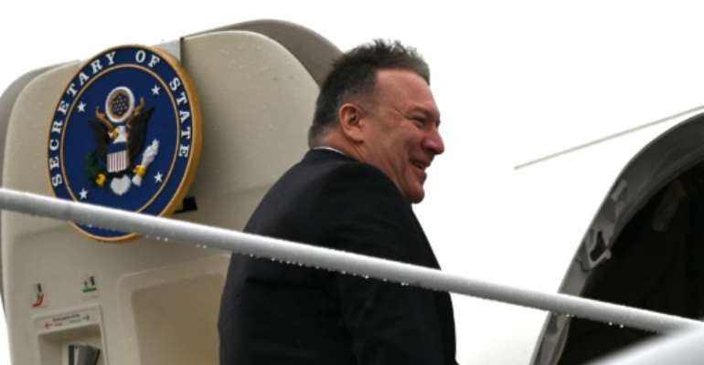 US Secretary of State Mike Pompeo boards his plane at Andrews Air Force Base en route to Munich on a trip that will include his first tour of sub-Saharan Africa.  By Andrew CABALLERO-REYNOLDS (POOL/AFP)