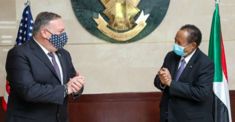 US Secretary of State Mike Pompeo (L) visited Prime Minister Abdalla Hamdok (R) of Sudan in August as the legislation was being prepared.  By Handout (Office of Sudan's Prime Minister/AFP/File)