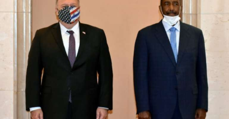 US Secretary of State Mike Pompeo poses for a picture with Sudan's top general Abdel Fattah al-Burhan in Khartoum on an August 2020 visit.  By - (AFP/File)