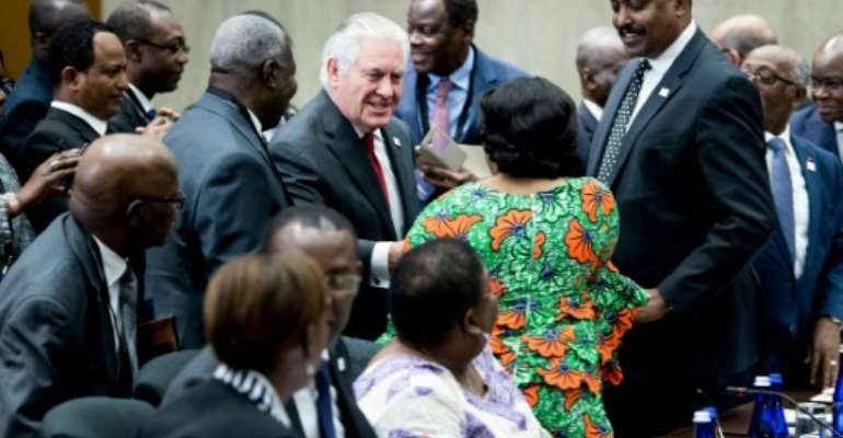 US Secretary of State Rex Tillerson greets participants during a meeting of African leaders at the State Department on November 17, 2017.  By Brendan Smialowski (AFP)