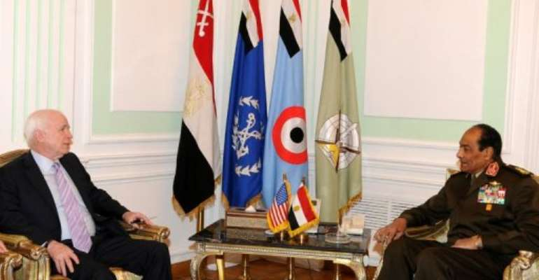 An official picture of US Senator John McCain (left) meeting Field Marshal Hussein Tantawi today.  By - (AFP)