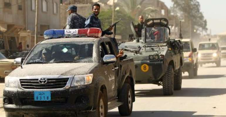 Security forces patrol a street in the Libyan city of Benghazi on June 25, 2014.  By  (AFP/File)