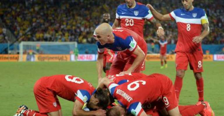 US defender John Brooks (C) celebrates with teammates after scoring during a Group G football match between Ghana and US at the Dunas Arena in Natal during the 2014 FIFA World Cup on June 16, 2014.  By Emmanuel Dunand (AFP)