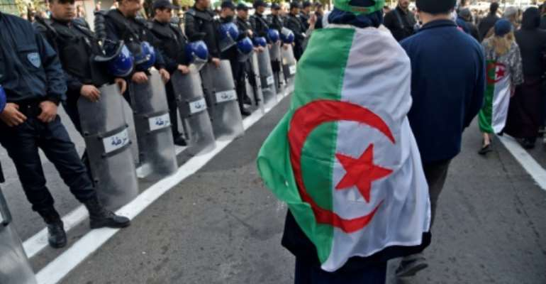 Vast demonstrations broke out in Algeria in February last year after then-president Abdelaziz Bouteflika announced a bid for a fifth term after 20 years in power.  By RYAD KRAMDI (AFP/File)