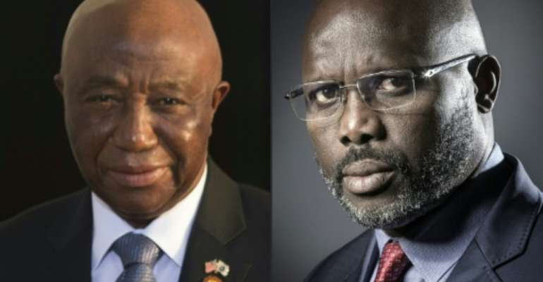 Vice President Joseph Boakai, left, will face off with former football star George Weah in Liberia's presidential runoff. But the vote -- scheduled for November 7 -- may be delayed because of a legal challenge.  By JOEL SAGET, Brendan SMIALOWSKI (AFP/File)