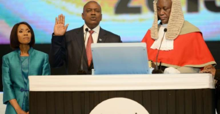 Victor: Mokgweetsi Masisi is sworn in as president after winning the October 23 elections.  By Monirul Bhuiyan (AFP)