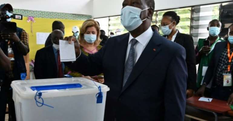 Victor: President Alassane Ouattara, casting his ballot in Abidjan on Saturday.  By Issouf SANOGO (AFP)