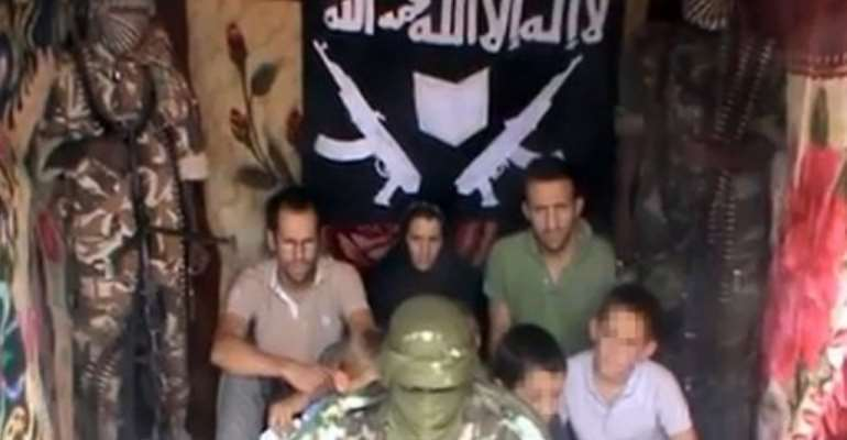 An image issued by YouTube on February 25, 2012 said to show Tanguy Moulin-Fournier (sitting left) with his family.  By  (Boko Haram va YouTube/AFP)