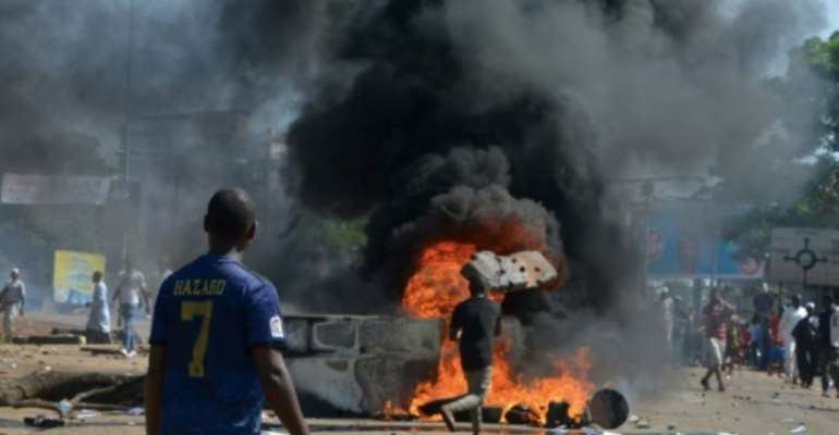 Violent protests have erupted over President Alpha Conde's plans for constitutional change.  By CELLOU BINANI (AFP)