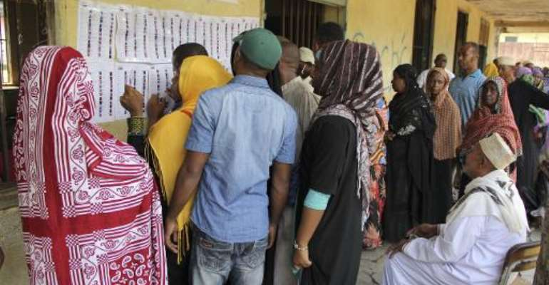 People queue outside a polling station in Mbeni, Comoros, during the parliamentary election on January 25, 2015.  By Ibrahim Youssouf (AFP)