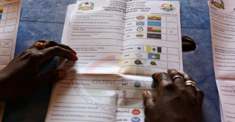 Voters in Guinea-Bissau cast ballots on March 10 to elect a new parliament hoping to end a leadership deadlock in a country renowned for drug trafficking and instability.  By SEYLLOU (AFP/File)