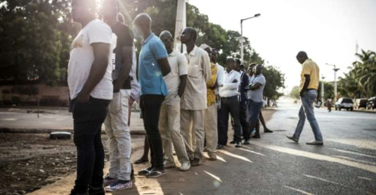 Voters line up at polls in Guinea-Bissau, where a presidential election is hoped to break a long-running deadlock.  By JOHN WESSELS (AFP)